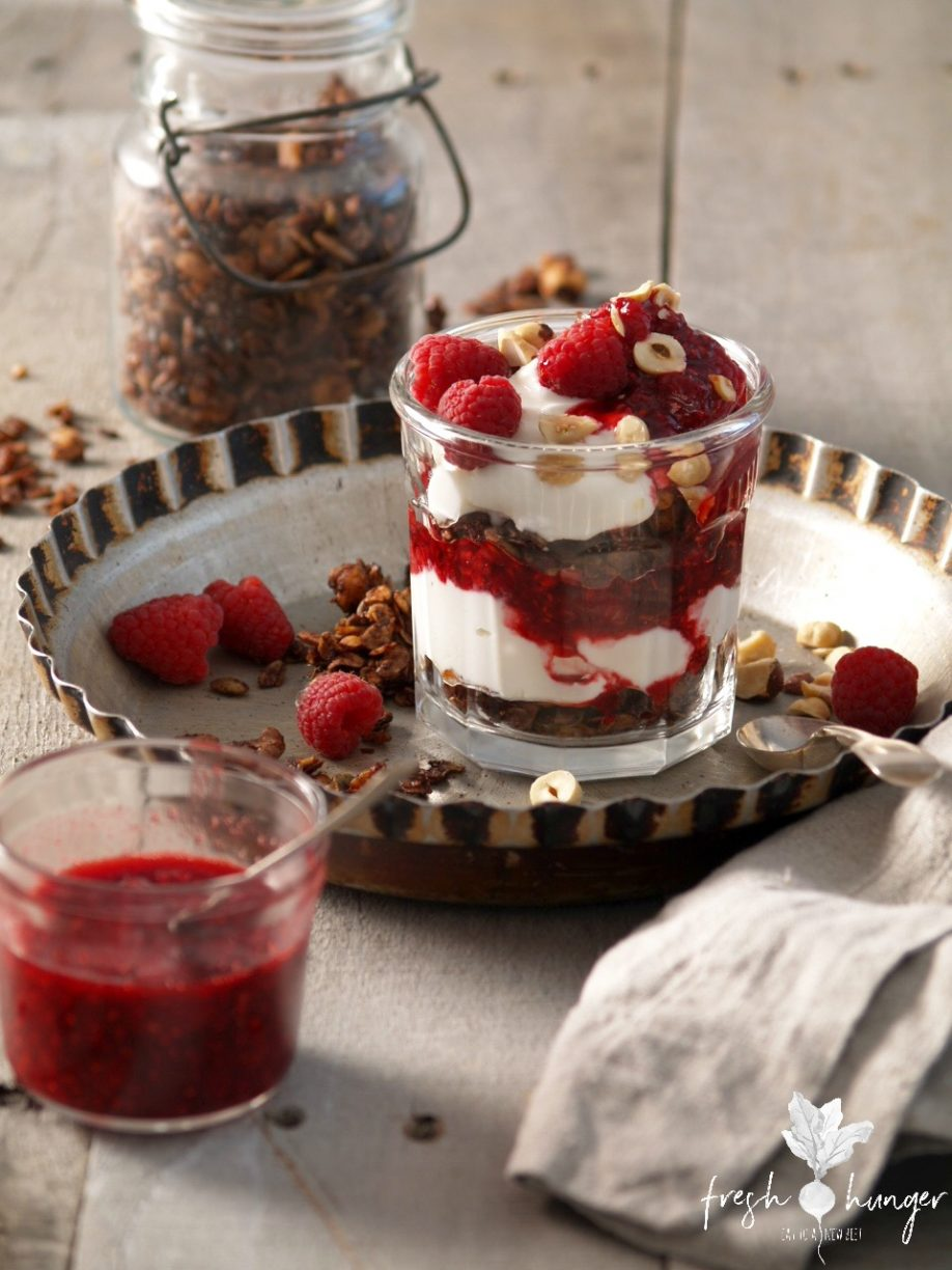 chocolate hazelnut granola with raspberries