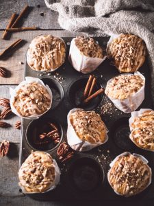 PEAR, PECAN & SOUR CREAM MUFFINS WITH CINNAMON GLAZE